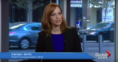 Carolyn Jarvis in a blue dress live on television.