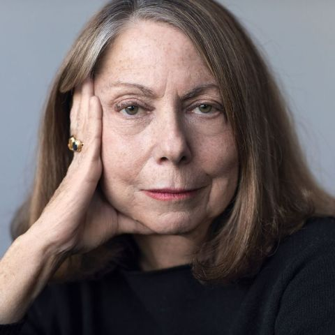 Jill Abramson in a black dress poses for a picture.