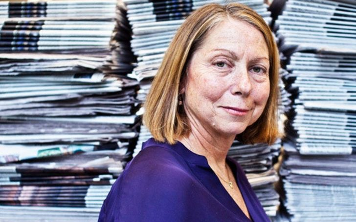 Jill Abramson in a blue dress poses for a picture.