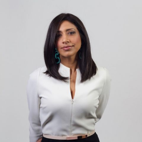 Farah Nasser in a white shirt poses for a picture.