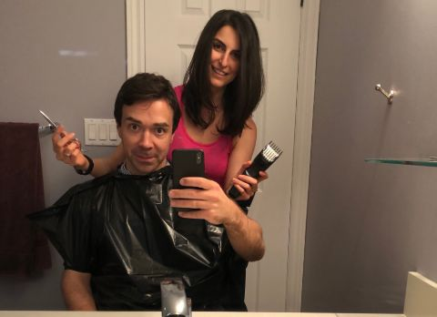 Jeff Semple poses for a picture while his wife does his hair.