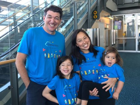 Aaron McArthur poses a picture with Elaine Yong and their kids.