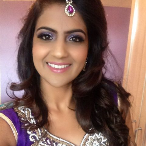 Sonia Deol  in  a purple traditional dress poses for a selfie