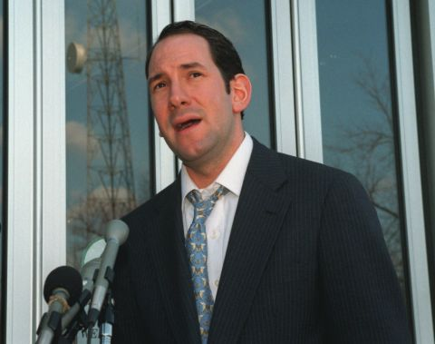 Matt Drudge in a black suit poses for a picture.