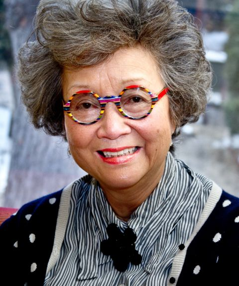 Adrienne Clarkson in a black dress poses for a picture.