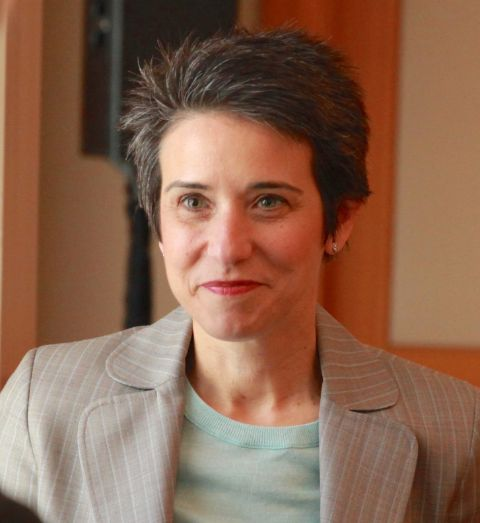 Amy Walter in a grey coat caught in the camera.