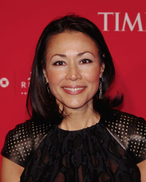 Ann Curry in a black dress poses for a picture.