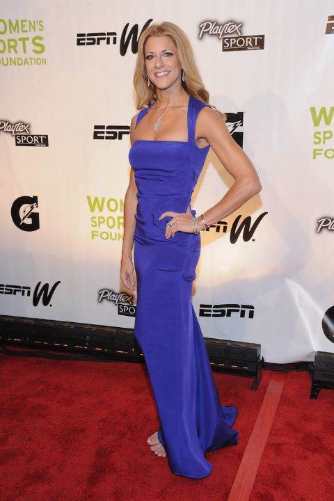 Bonnie Bernstein in a blue dress poses for a picture.