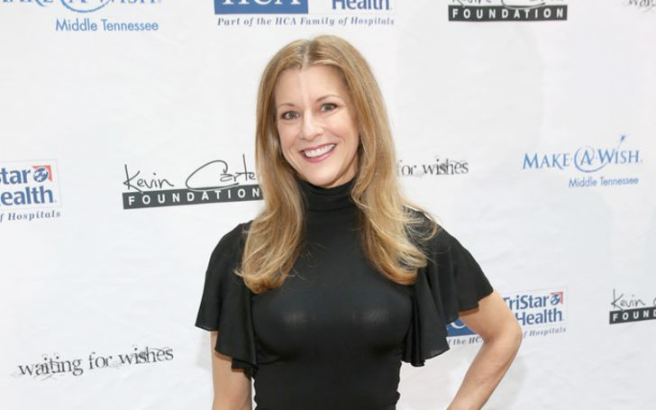 Bonnie Bernstein in a black t-shirt poses for a picture.