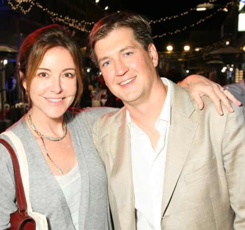 Bill Lawrence and his wife Christa Miller pose for a picture.