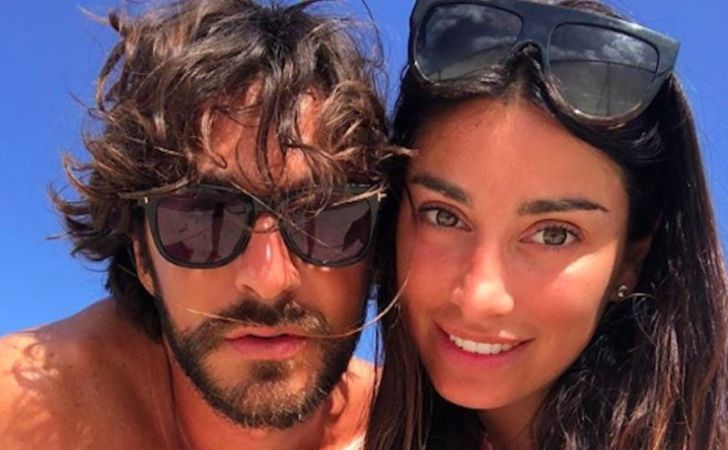Andrea Grilli and his wife Giorgia Gabriele pose for a picture.