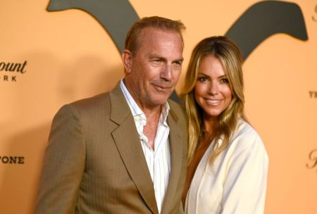 Kevin Costner and his wife Christine Baumgartner pose for a picture.