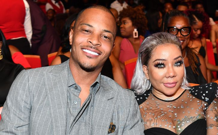 Leyah Amore Harris's parents Tiny Harris and T.I pose for a picture