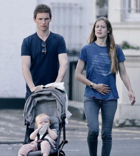 Actor Eddie Redmayne and wife Hannah Bagshawe with their kid.