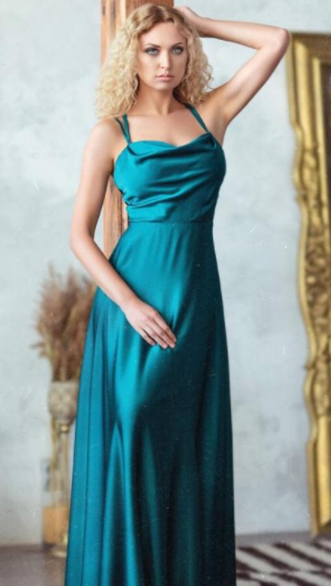 Natalie Mordovtseva in a blue dress
