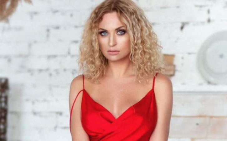 Natalie Mordovtseva in a red dress at a red carpet