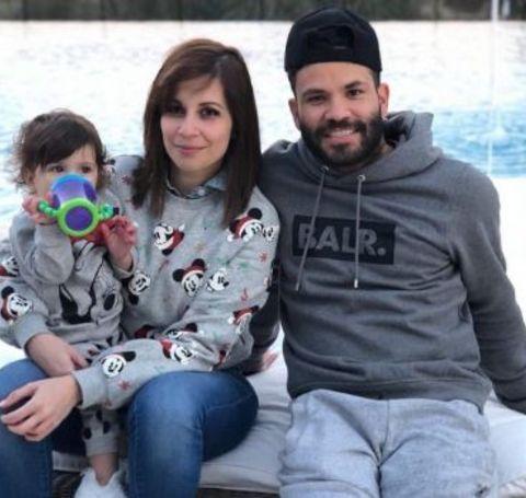 Nina Altuve and her husband Jose Altuve with their daughter.