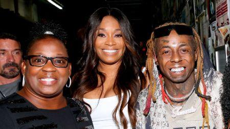 Lil Wayne with his mother Jacida Carter during an event.