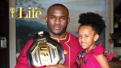 Kamaru Usman with his daughter