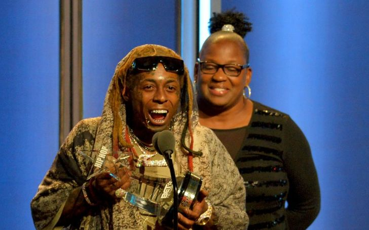 Lil Wayne and his mother Jacida Cater during a ceremony.