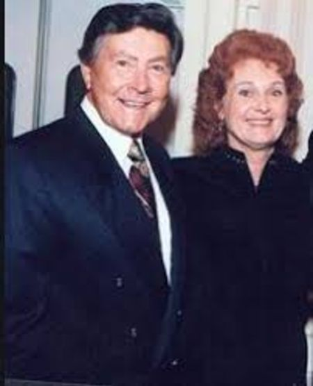 Johnny Gilbert tied a knot with Sheree Gilbert in 1984.