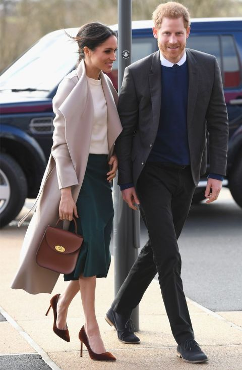 Meghan Markle adorning her look the Bloomsbury bag from Charlotte Elizabeth.