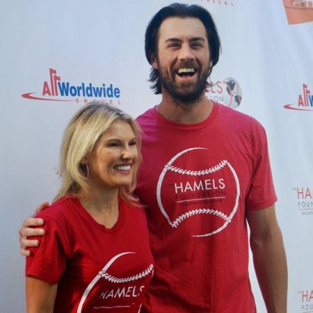 Cole Hamels poses for a picture with his wife.