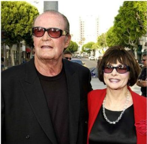 Lois Clarke with American actor and producer James Garner sharing stage.