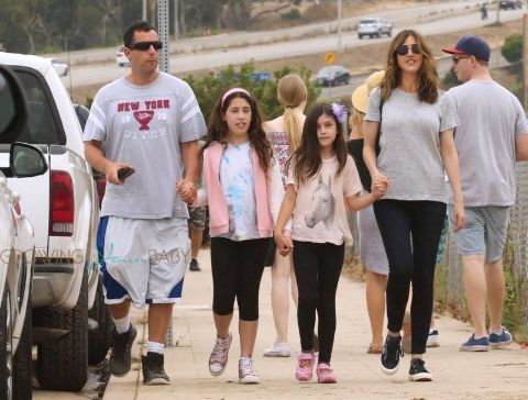Sadie walking with her family. They are in a Vacation.