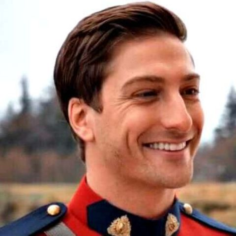 Daniel Lissing is smiling and wearing a cloths of When Calls the Heart.