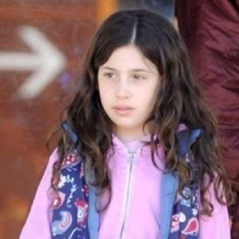 Little Sadie walking in shopping hall.