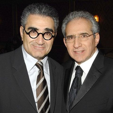 Fred Levy and his brother Eugene Levy attending a party or award function.
