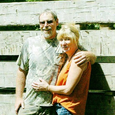 Sherman Thompson with his wife in field.